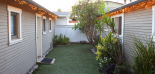 Backyard Patio, faux grass area, view of entry to casita