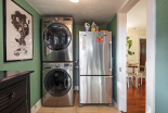 Laundry room with refrigerator and pantry space