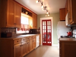 Kitchen, view of laundry room with London phone booth doors