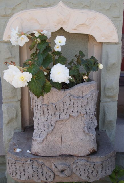 Concrete planter with tree bark detail